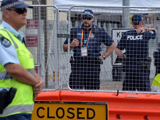 Queensland police stand guard at one of the entry points