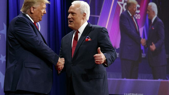 President Donald Trump is greeted by Matt Schlapp, Chairman of the American Conservative Union, as the president arrives to speak at the Conservative Political Action Conference on Feb. 29, 2020 at National Harbor, in Oxon Hill, Md.