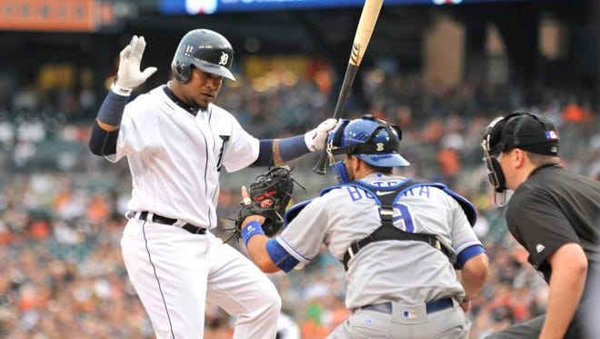 Tigers shortstop Erick Aybar, left, gets out of the way of ball four and walks in the third inning against the Royals at Comerica Park in Detroit.