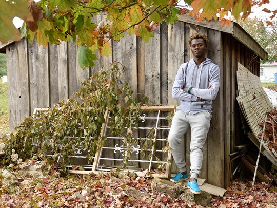 Haitian immigrant Jean Radyn Piard in the backyard of his home in Teaneck. He will be celebrating his fist Thanksgiving in the US this year.
