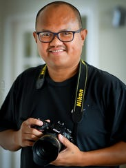 "Isabelo ""Izzy"" Cagalawan, 47, of Macomb started out as a photo hobbyist posting his favorite shots on Instagram, but his work has since been recognized and featured in the #Nikon100."