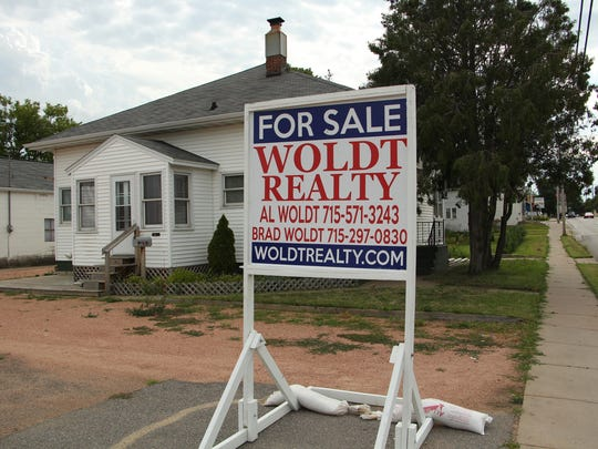 Many properties, residential and commercial are for sale along Thomas Street in Wausau.