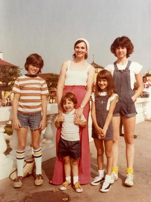Judy Jenkins and her four children (from left), Shane, Josh, Jennifer and Jodie, pose for a photo during a family trip to King's Island in 1978.