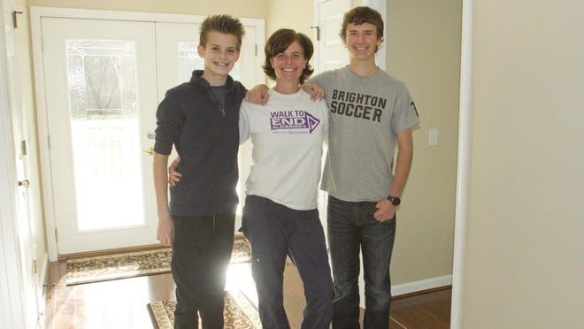 Holly Purdy, R.N., has opened Blue Heron Pond Adult Foster Care in Green Oak Township, and will live on-site with her sons 13-year-old Jack Purdy, left, and 16-year-old Noah Purdy.