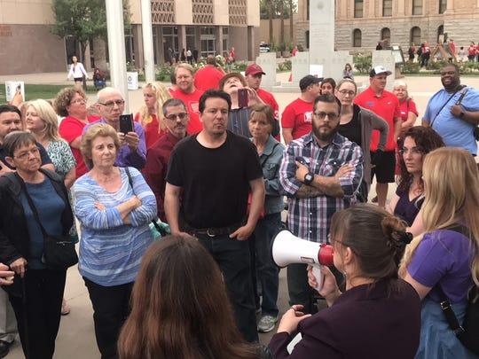 Several #PurpleForParents supporters express their concerns about the #RedForEd movement during a counterprotest at the Arizona Capitol on May 1, 2018.