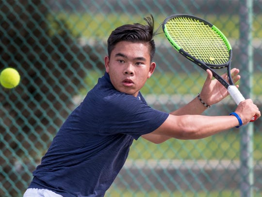 Tulare Western's Martin Tran plays in the #1 boys singles tennis match against West Bakersfield on Tuesday, May 8, 2018.
