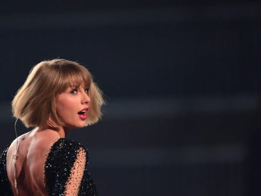 "Taylor Swift, one of the top-selling pop stars of recent years, on August 23, 2017 announced a new album, ""Reputation,"" to be released on November 10. The 27-year-old singer, who this week has been sharing cryptic videos of a snake showing its fangs, revealed little else about her sixth studio album but said a first single would come out Thursday. (Photo: Robyn Beck, AFP/Getty Images)"