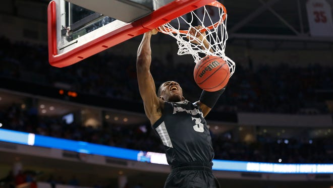 Providence Friars guard Kris Dunn (3) dunks the ball against the North Carolina Tar Heels in the second half during the second round of the 2016 NCAA Tournament at PNC Arena.