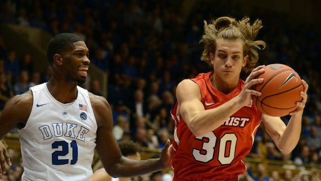 Marist Red Foxes forward Ryan Funk, right, pulls down a rebound in front of Duke Blue Devils forward Amile Jefferson at Cameron Indoor Stadium in the season-opening game for both teams on Nov. 11.
