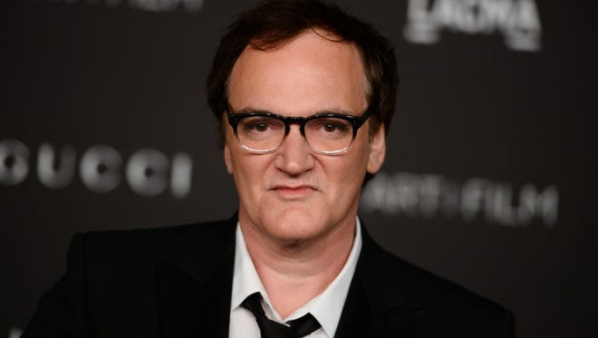 In this Nov. 1, 2014, photo, honoree Quentin Tarantino arrives at the LACMA Art + Film Gala at LACMA in Los Angeles.
