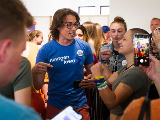 University of Iowa student Ryan Hall (left) talks with Emma Gonzalez, a high school student from Parkland, Florida, and organizer for the March for Our Lives, during an event hosted by NextGen Iowa featuring members of the March for our Lives group at Raygun on Thursday, June 21, 2018 in Cedar Rapids. Cedar Rapids was the second stop on the tour through Iowa this week.