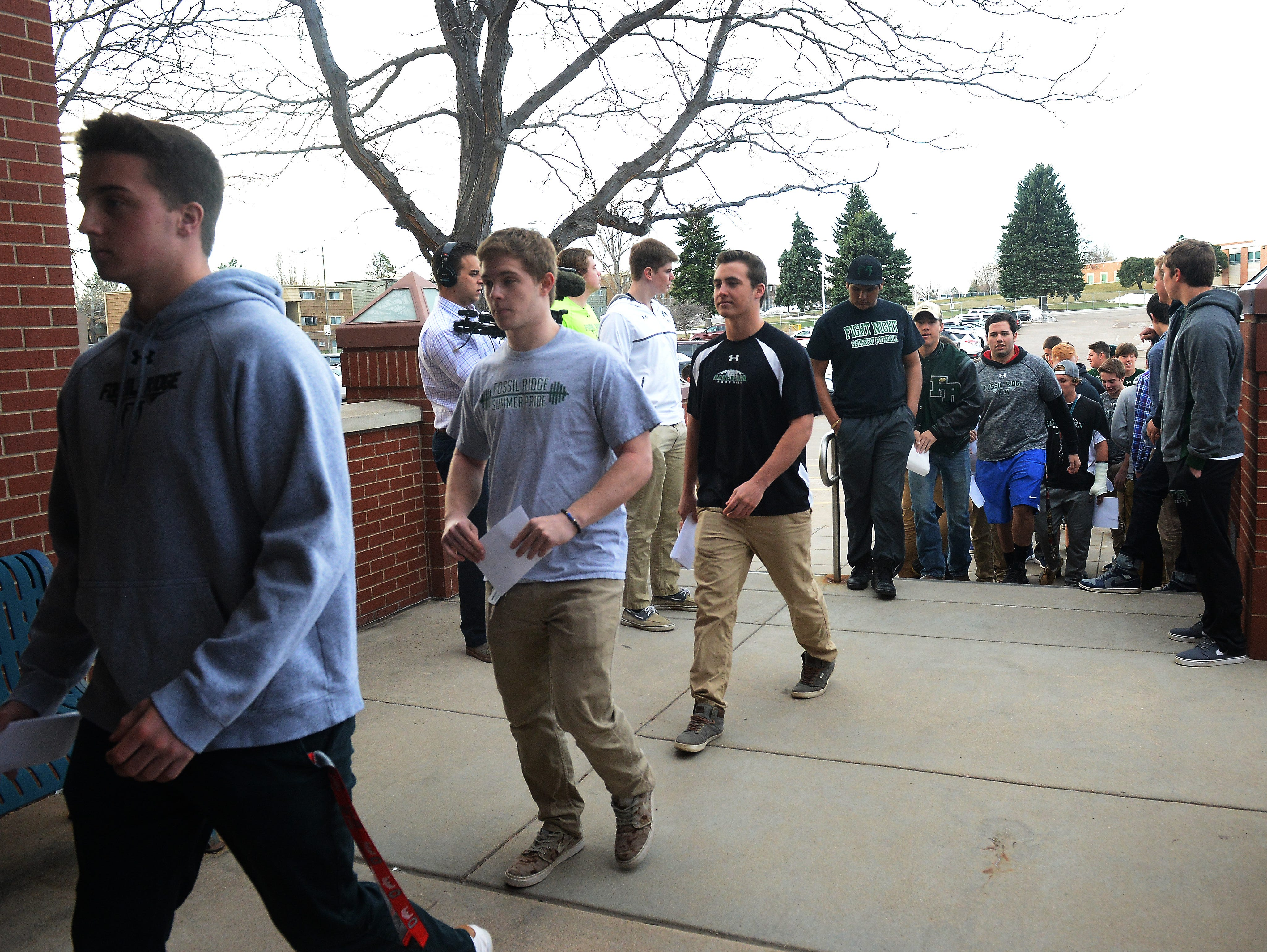 Fossil Ridge football players showed up at the PSD offices to protest the firing of coach Brian Tinker on Monday.