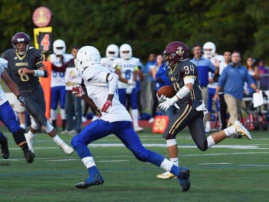 Arlington's Louis Mezzone takes the ball down the field