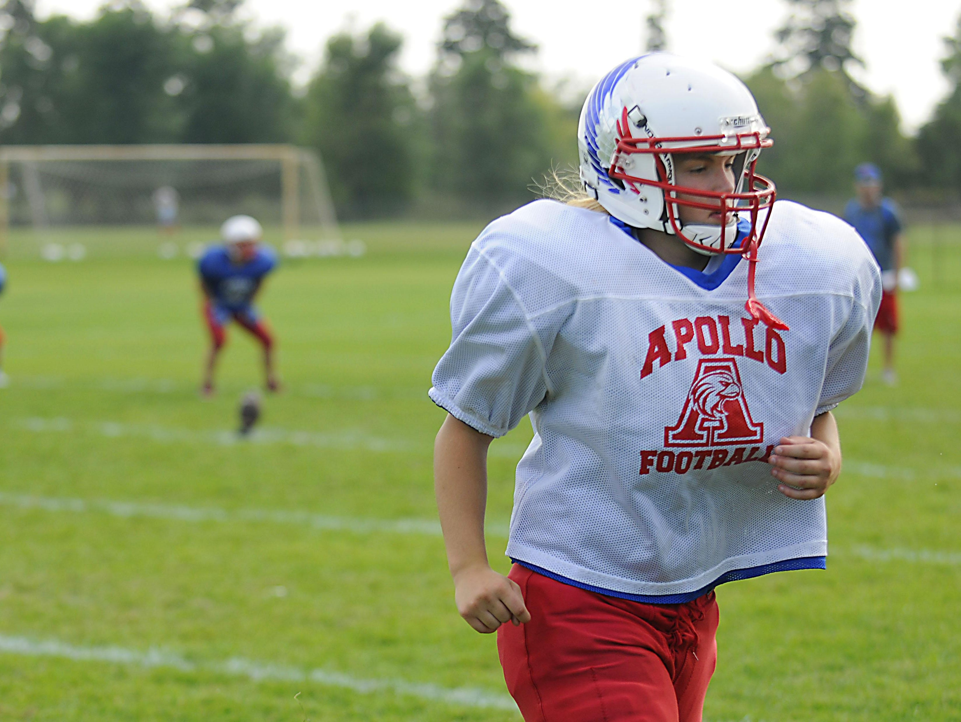 Linebacker Angie Stolt jogs off the field at practice on Wednesday at Apollo High School.