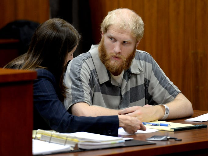 Grant Taylor talks with his attorney Stacia Buchanan