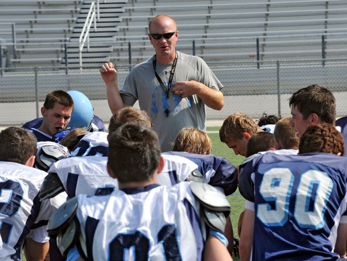 Preseason football practice at Enka High School. Head coach Jeff Frady conducted practice two days after teammate Christopher Taylor was killed in a car accident. 7/31/14. Robert Bradley (rbradley@citizen-times.com)