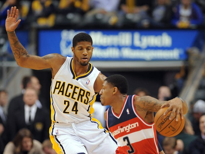 Indiana Pacers forward Paul George defends Washington Wizards guard Bradley Beal inside Bankers Life Fieldhouse, Friday, January 10, 2014, in Indianapolis.
