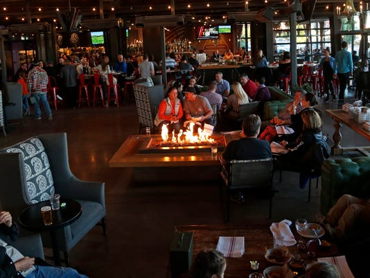 Seventh Street Phoenix hub | the Yard, people gathered around fire pit