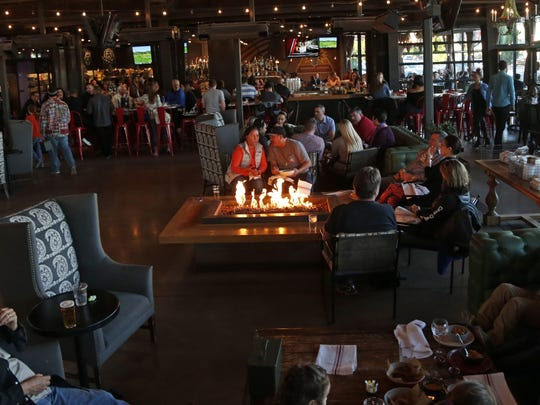 The Yard has locations in Phoenix (pictured here) and Tempe, with Culinary Dropout as the main restaurant anchor. The enclosed patio features plenty of comfortable seating, televisions and backyard games.