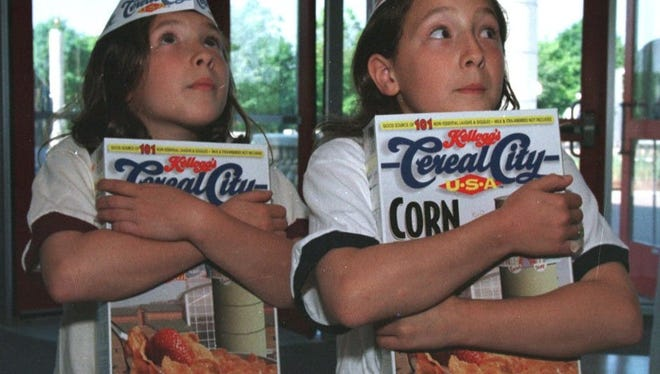 Sisters Hannah (L) and Allegra Hulsey check out the inside of Cereal City USA in 1998.