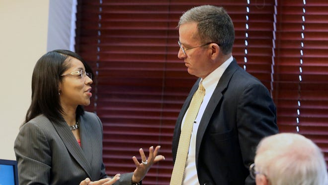 Orange County (Fla.) State Attorney Aramis Ayala, left, talks with State Attorney Brad King, the newly appointed prosecutor in the Markeith Loyd case on March 20, 2017. On Tuesday, March 28, 2017, a Florida judge ruled the case of the suspected killer of an Orlando police officer will move forward under King who was appointed by Florida Gov. Rick Scott.