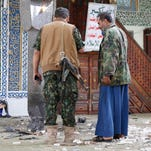 Shiite fighters, known as Houthis inspect the inside of the al-Balili mosque after two suicide bombings at the mosque during Eid al-Adha prayers in Sanaa, Yemen, Thursday, Sept. 24, 2015.