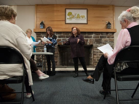 Acting teacher Karen Scioli of Haddon Heights (center) directs a group of Haddon Heights seniors as they rehearse a murder mystery, 'Murder in the Heights,' which will be staged in the borough on Dec. 15.