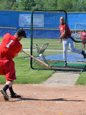 The Battle Creek Bombers open the 2018 season this week and went through their first practice on Monday as hitting coach Jason Godbee throws to Connor Bailey.