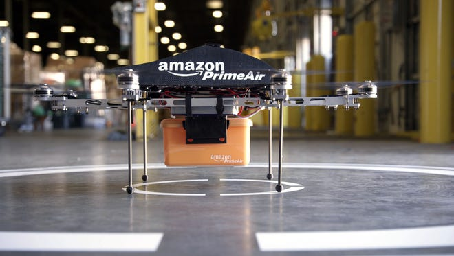 This undated image provided by Amazon.com shows its Prime Air unmanned aircraft project that Amazon is working on and hopes to use eventually for delivery of products. New FAA drone rules pose obstacles, the company said Sunday.