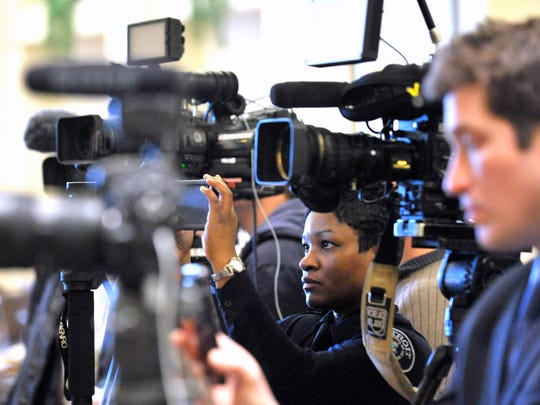 DPD police officer / public information officer Nicole Kirkwood, center, shoots video for the department's social media platforms and for internal use as she is surrounded by members of the media.