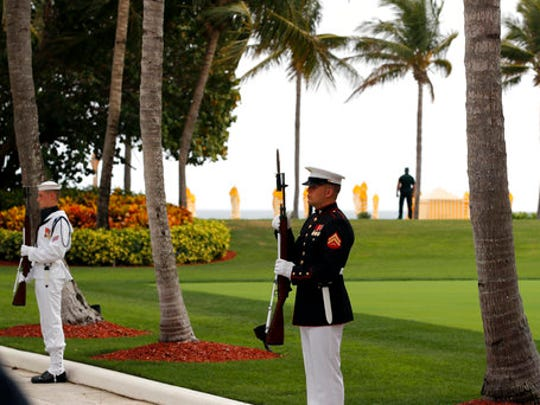 FILE - In this April 6, 2017 file photo, military personnel stand for the arrival of Chinese President Xi Jinping and his wife Chinese first lady Peng Liyuan at Mar-a-Lago in Palm Beach, Fla. to meet with President Donald Trump and first lady Melania Trump. It's widely estimated that each trip to the resort costs taxpayers $3 million, based on a government study of the cost of a 2013 trip to Florida by President Barack Obama. But that trip was more complicated and the study's author says it can't be used to calculate the cost of Trump's travel. This weekend, Trump is making his seventh visit to Mar-a-Lago since becoming president.