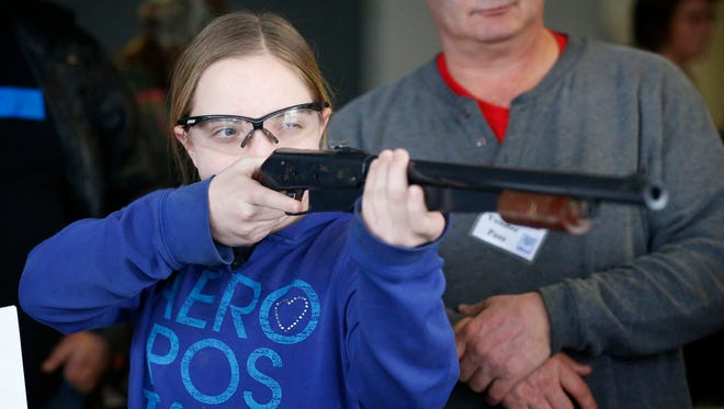 Millport resident Rebekah Merrill, 12, fires at metal targets with a cork gun Saturday at Big Game Recovery Service's booth at the Twin Tiers Outdoor Expo at First Arena.