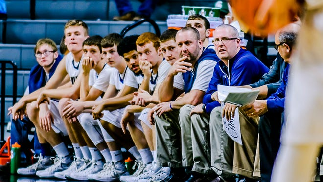 The Fulton bench looks on as Powers North Central takes a 22-4 lead during the 2nd quarter of their Class D state semifinal game Thursday March 24, 2016 at the Breslin Center in East Lansing.  KEVIN W. FOWLER PHOTO