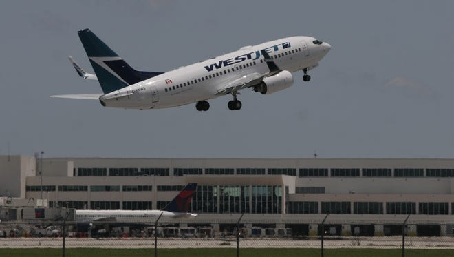 A WestJet aircraft takes off from RSW on Tuesday.