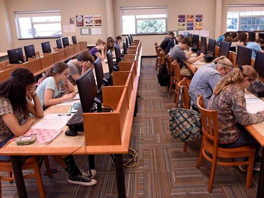 AP Boot Camp participants take a test Thursday, June