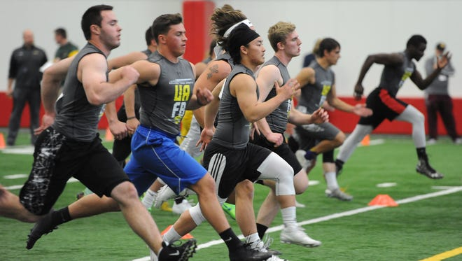 Participants warm up before the Wisconsin Football Coaches Association combine in 2017. The event is back for its fifth year this weekend, which makes it about the only sporting event on the calendar.