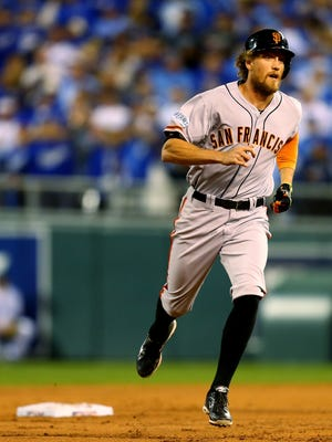 KANSAS CITY, MO - OCTOBER 21:  Hunter Pence #8 of the San Francisco Giants rounds the bases after hitting a two run home run in the first inning against James Shields #33 of the Kansas City Royals during Game One of the 2014 World Series at Kauffman Stadium on October 21, 2014 in Kansas City, Missouri.  (Photo by Dilip Vishwanat/Getty Images)