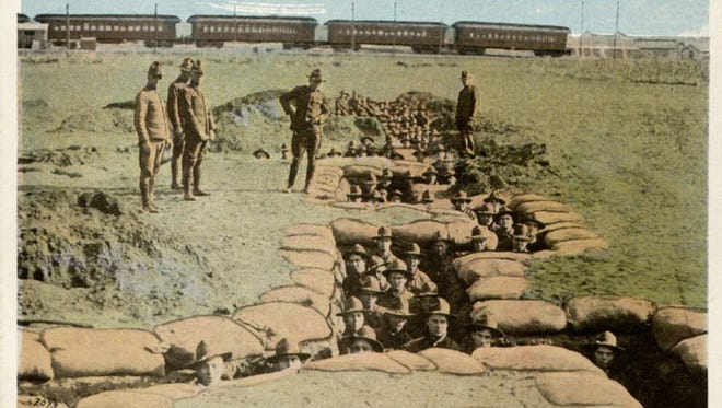 Camp Dodge was the site of training for soldiers in World War I before they went sent to fight in France. This postcard shows trenches dug at Camp Dodge. Remnants of the trench still exist at Camp Dodge.