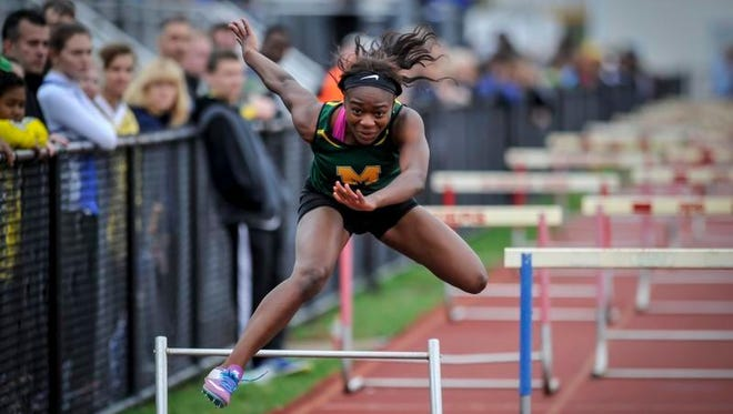 Montgomery's Queen Divine hits the top of the hurdle in the 4X100 shuttle hurdles during the Raider Relays on Saturday at Hillsborough.