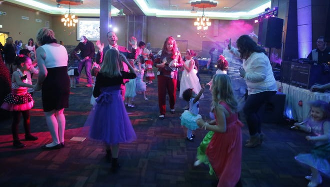 Parents dance with their children during Saturday night's Mom Prom at the Farmington Civic Center.