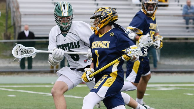 Pequannock's Matt Gallo moves the ball as Montville's Mike Burke defends during the second half of a boys lacrosse at Montville High School on April 09, 2018.
