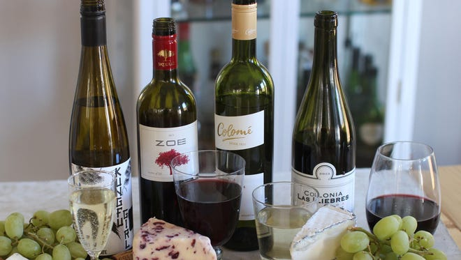 Four wines for under $15, are, from left, Kungfu Girl, a Columbia Valley Riesling from Washington state; Zoe Red Peloponnese, from Greece; Colome, from Argentina; and Colonia, also from Argentina.