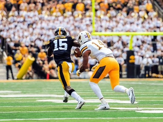Iowa's Josh Jackson intercepts a pass against Wyoming at Kinnick Stadium.