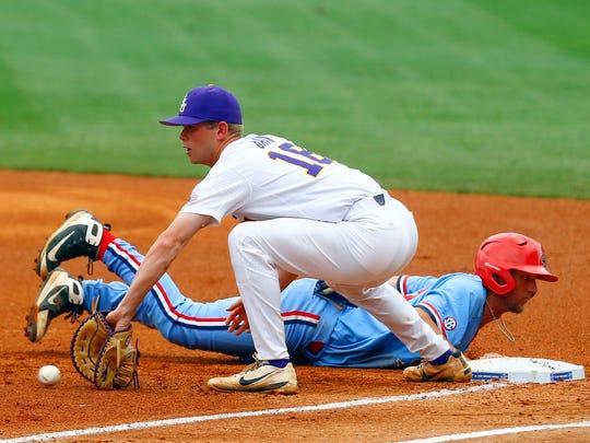 Mississippi's Grae Kessinger, right,  beats the throw