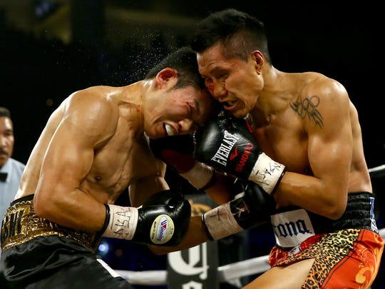 Francisco Vargas, right, boxes Takashi Miura during their WBC super featherweight title fight at the Mandalay Bay Events Center. (Getty Images)