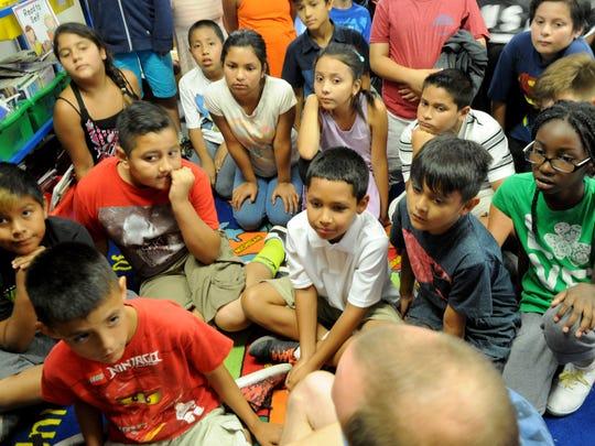 Teacher Derek Murphy shows his fifth-grade class at