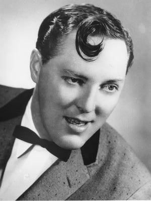 "This is a photo of Bill Haley taken in January, 1957. He is the lead singer of the rock-and-roll group ""The Comets,"" whose famous song is ""Rock Around the Clock."" He was born in 1927 and died in 1981."