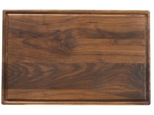 The Virgina Boys Kitchens walnut cutting board is unfinished, a nice detail for home cooks obsessive about what goes into their food.