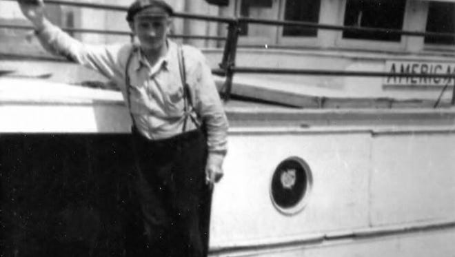 John Anderson with his boat the American Girl.