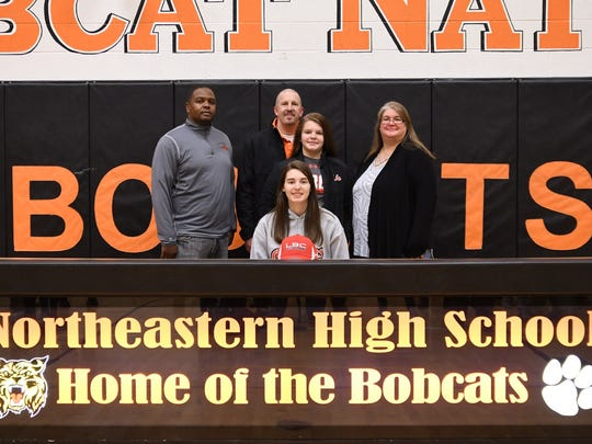 Katie Baker, center, signs her letter of intent to play basketball at Lancaster Bible College.